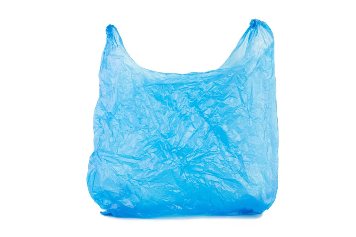 A blue plastic carrier bag isolated on white